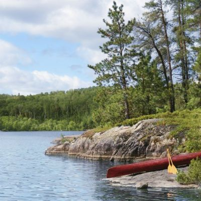 canoe on rocky shore of river