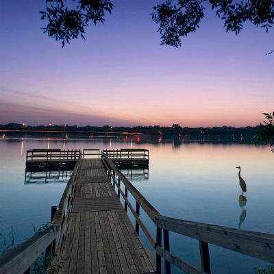 Dock stretching into lake at evening