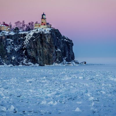 Split Rock lighthouse overlooking frozen Lake Superior